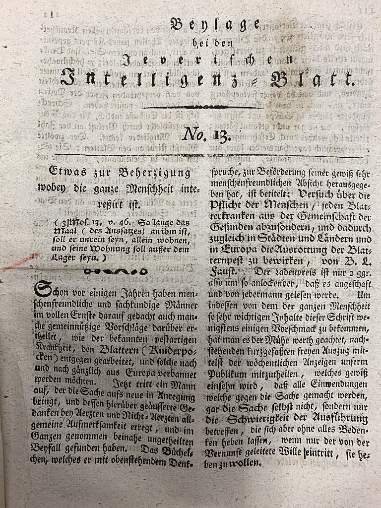 Rezension von B. L. Faust 'Versuch über die Pflicht der Menschen jeden Blatternkranken aus der Gemeinschaft der Gesunden abzusondern, und dadurch zugleich in den Städten und Ländern und in Europa die Ausrottung der Blatternpest zu bewirken' in der Beilage des 'Jeverischen Intelligenz-Blattes' Nr. 13 von 1795, in der strikte Quarantäne-Regeln für Erkrankte gefordert werden